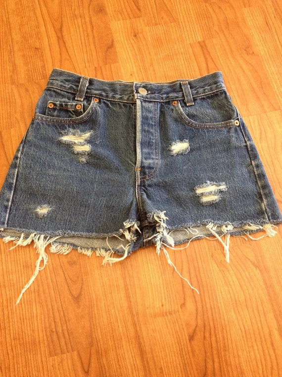 Levi vintage high waisted distressed shorts size small.