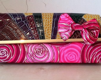 "African Fabric Pink ""Ankara"" and Leather Bow Detail Clutch Bag."
