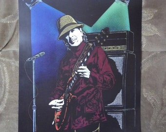 """Carlos Santana in Concert is a Limited Edition, 10""""x13"""", numbered Print of the Original Artwork by Artist Charles Freeman"""