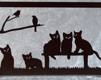 Cats silhouettes cut wood