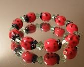 Girls Ladybug and peridot bracelet