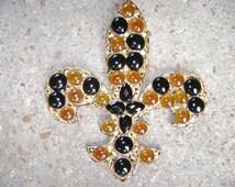 Black and gold wooden fleur de lis