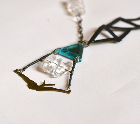 Quartz, blue glass and leather geometric swallow gemstone statement necklace.
