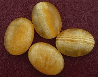 one 30x22 oval golden jade cabochon gem stone gemstone