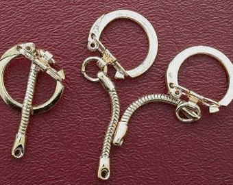 three gold-color keychain findings