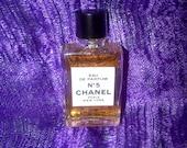 Miniature iconic rectangular bottle of Vintage Chanel No 5