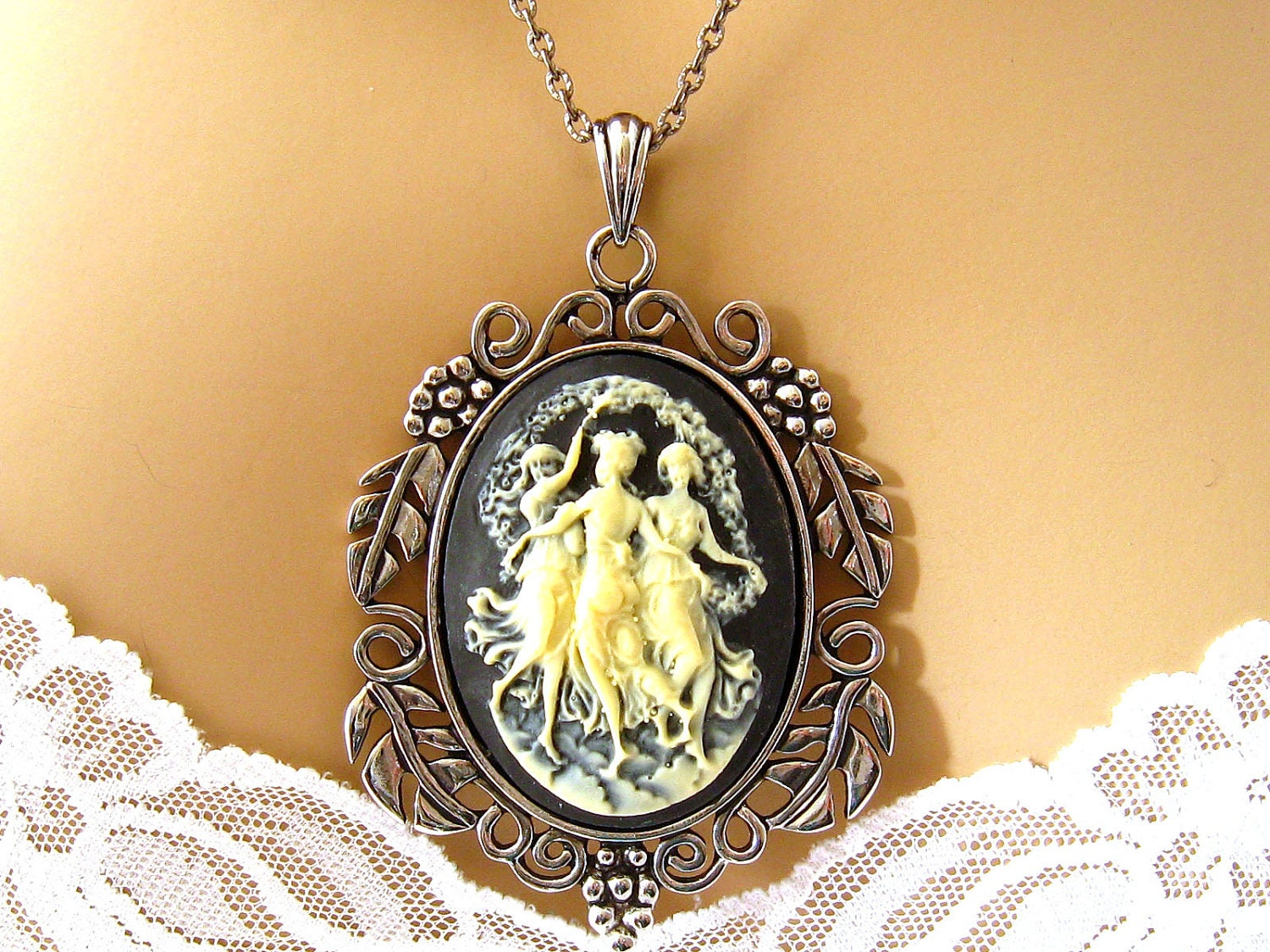 ornate black cameo necklace the three muses black cameo