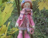 Handmade rag roze doll with heart and hat