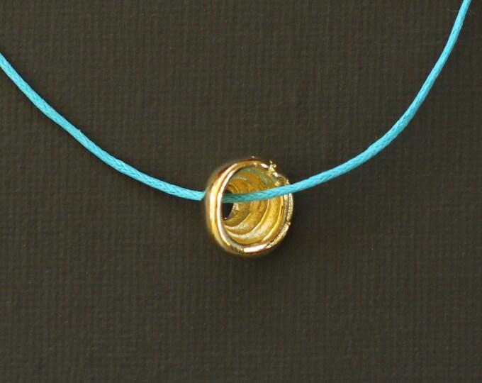 Gold Hawaiian Puka Shell Necklace on Turquoise Cord