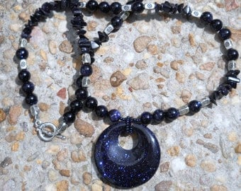 Navy blue sparkling goldstone pendant necklace with silver accents