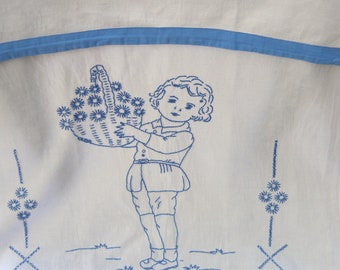 Child with basket of flowers. Embroidered hand towel- probably 40s. Monogrammed MW. With blue border