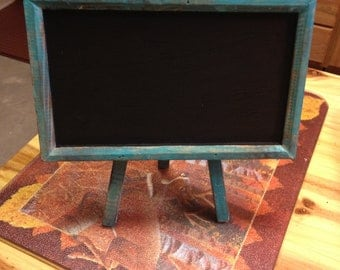 Turquoise wooden standing chalk board