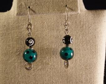 Green and black earrings