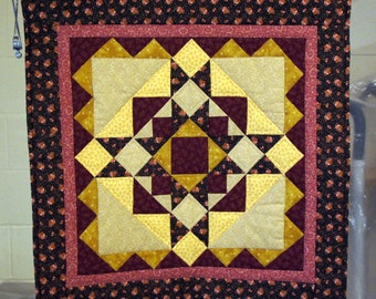 Harvest Star wallhanging in burgundy browns and golds