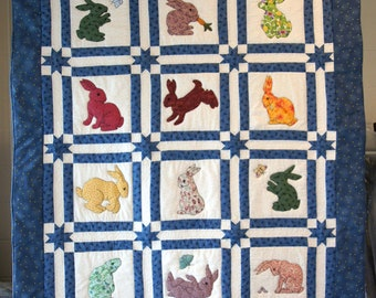 Bunnies playing Baby Quilt 12 rabbits