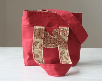red purse with paisley lining