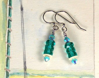 Water Poppies Turquoise colored glass and crystal earrings on silver toned ear wires
