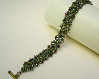 Filigree bracelet with sparkling beads in Grünmetallic/multicolor
