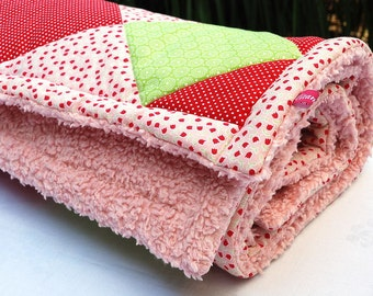 Patchwork quilt red pink green