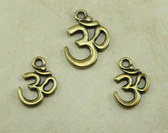 3 TierraCast Om Ohm Aum Pendant and Charm Mix Pack - Brass Ox Plated Lead Free Pewter - I ship Internationally