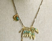 Peacock.vintage assemblage emerald green charm necklace. tiedupmemories