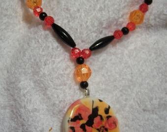 Orange and Black Ceramic Necklace