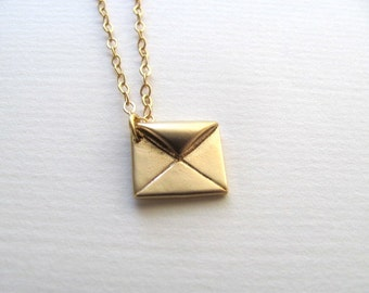 Petite golden envelope charm necklace on delicate 14k gold plate chain