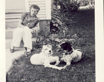 Woman Leaning Into Photo of TWO DOGS That Appear to be Best Friends Photo Circa 1940s