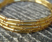 Gold bracelet, gold coloured beaded bracelet, gold coiled bracelet, beaded jewellery