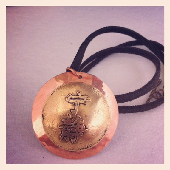 "Etched brass and copper serenity symbol inspired by ""Firefly"""