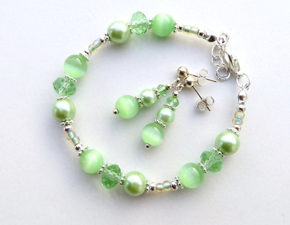 GREEN CLOVER- Silky Green Pearl Beaded Bracelet and Nickel Free Post Earrings- Swarovski Crystals, Soft Pearls and Cat's Eye Beads