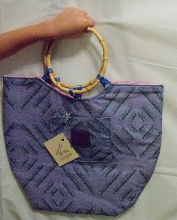 Blue  purse with ring handles
