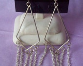 E26- Silver chandelier earrings with teal and clear Swarovski crystals