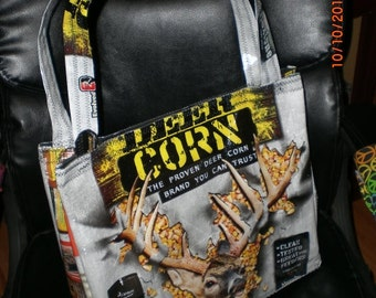 Tote lined with pocket and closure made from recycled  Deer Corn feedbag and other upcycled materials