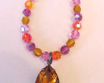 Beautiful Necklace of Brilliant Pink, Purple and Orange Crystals