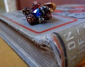 The Atlantis Ring- Hemitite band, gun metal grey ring with copper wire wrapped beads of blue, copper, pearl, and silver swarovski crystals