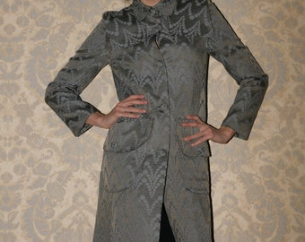 Autumn  trench coat with large pockets and cape made to order