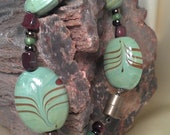 Lovely hand painted ceramic beaded bracelet with brown cats eye bead chips and magnetic clasp