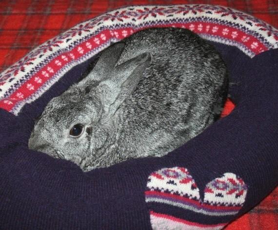 Ugli Donut rabbit bed for a medium sized bunny purple heart Nordic pattern wool