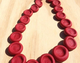 Dimple Necklace in red: deep & richly textured handmade beads create a stimulating piece.