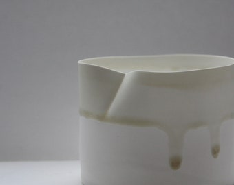 White vessel. Fine English white bone china vessel in stoneware with ivory color drip effect.