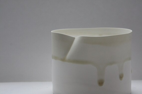 White vessel. Fine English white bone china vessel in stoneware with ivory color drip effect.