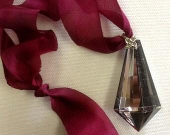 Vintage glass pendant on silk ribbon