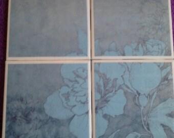 Set of 4 decoupaged tile coasters. Light blue flowers.