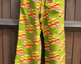 Party Pants - Green, yellow, pink African print wide leg trousers with elastic & drawstring waist with front pockets. Size M
