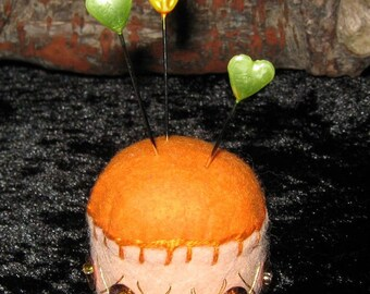 Recycled Bottle Cap Mini Pin Cushion made from Felt and decorated with sequins Orange