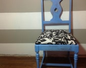 Distressed Sky Blue Chair with a Black and White Leaf Fabric