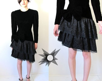 Vintage 80's Black Velvet Long Sleeve Dress with Lace Tiered Asymmetrical Mini Skirt and Large Bow Size S/M