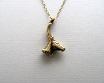 Deer pendant necklace on delicate 14k gold plate chain