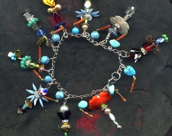 Handmade charm bracelet,The Bouquet Bracelet. handmade floral charms, flower charms,gift for her,OOAK flower charms,unique charm bracelet
